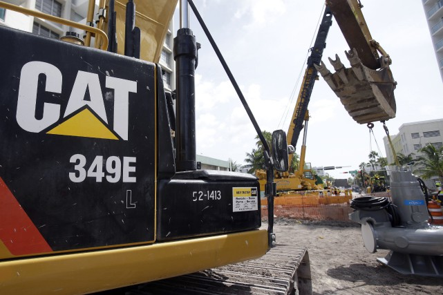 Caterpillar, le fabricant américain d'engins de chantier et de construction, a... (Photo Wilfredo Lee, archives AP)
