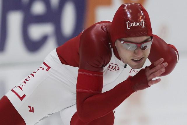 Laurent Dubreuil a pris le sixième rang du... (Archives AP, Alexei Filippov)