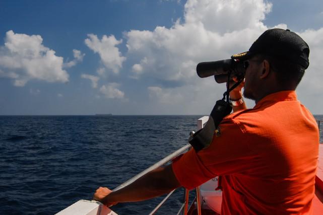 Un bateau transportant 31 personnes, parmi lesquelles 28 touristes chinois, est... (Photo archives AFP)