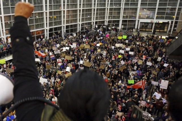 Les manifestations en réaction au décret de Donald... (Genna Martin/seattlepi.com via AP)