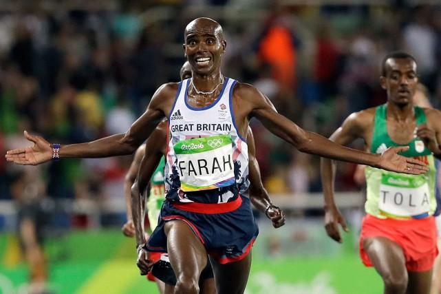 Le quadruple champion olympique 5000 m et 10000m,... (Photo David J. Phillip, archives AP)