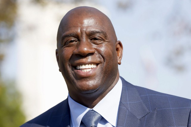 Magic Johnson est le nouveau président aux opérations basketball... (Photo Nick Ut, archives AP)