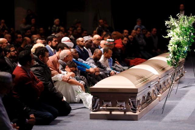 L'attentat de Québec n'aura pas fait six victimes, mais bien sept. Dans une... (AFP, Mathieu Bélanger)