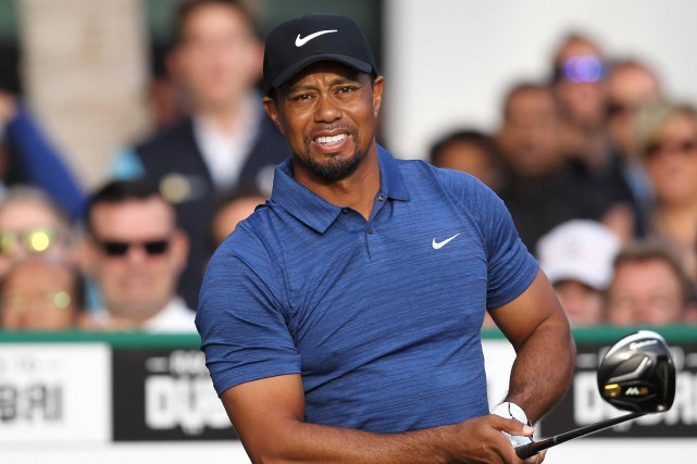 Tiger Woods a éprouvé des spasmes au bas... (Agence France-Presse)