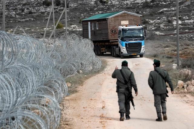 Israël a commencé lundi à démanteler Amona, colonie... (AFP, Thomas Coex)