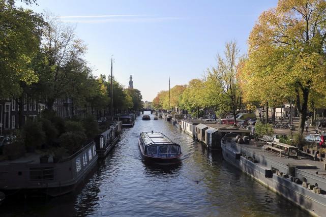 Amsterdamqui compte 830 000 habitants, accueille chaque année... (AP, Margriet Faber)