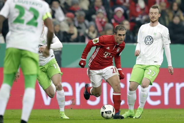 Philipp Lahm atout gagné: une Ligue des champions... (Photo Matthias Schrader, archives Associated Press)