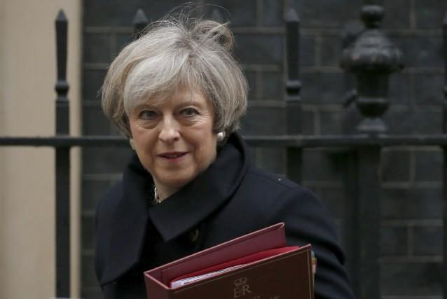 Avec le vote de mercredi, la première ministre... (AP, Alastair Grant)