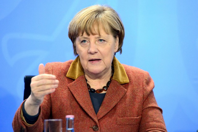 La chancelière allemande Angela Merkel... (AFP, Maurizio Gambarini)