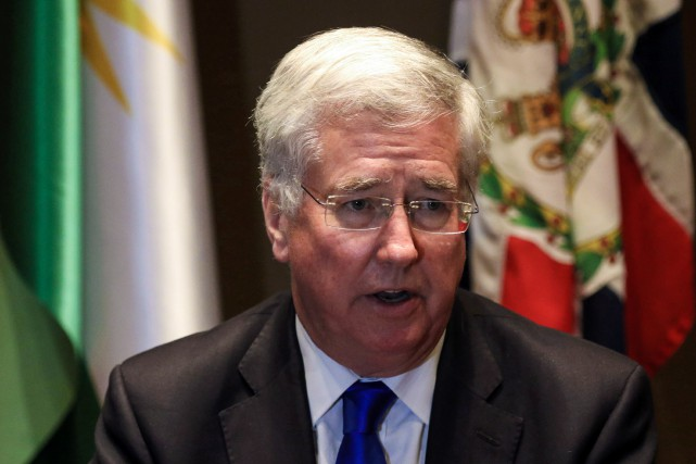 Le ministre anglais de la Défense, Michael Fallon... (PHOTO SAFIN HAMED, AFP)