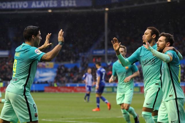 Luis Suarez, Neymar et Lionel Messi, du FC... (Photo Cesar Manso, AFP)