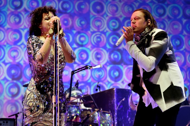 Régine Chassagne et Win Butler d'Arcade Fire lors... (PHOTO ARCHIVES AFP)