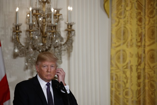 Donald Trump a aussi défendu sa politique de... (Photo AP)