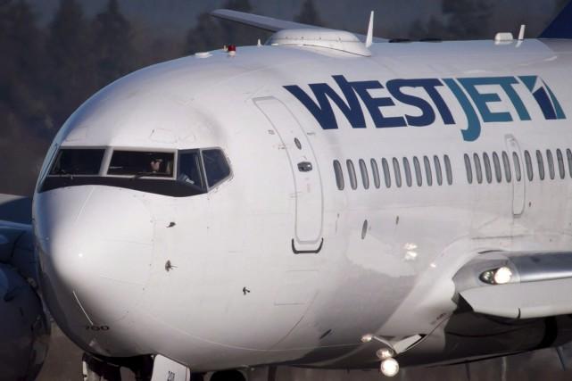 Le transporteur Westjet... (La Presse canadienne)