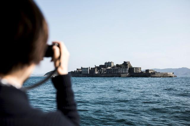 Hashima, surnommée «l'île cuirassée», abritait des mineurs qui... (AFP, Behrouz Mehri)