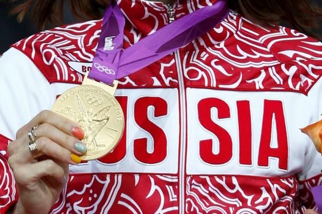 Les athlètes russes trouvés coupables de dopage qui refusent de retourner leur... (Photo Eddie Keogh, archives reuters)