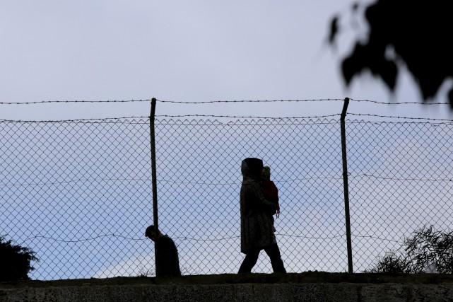 Les pourparlers entre Chypriotes grecs et Chypriotes turcs... (AP, Petros Karadjias)