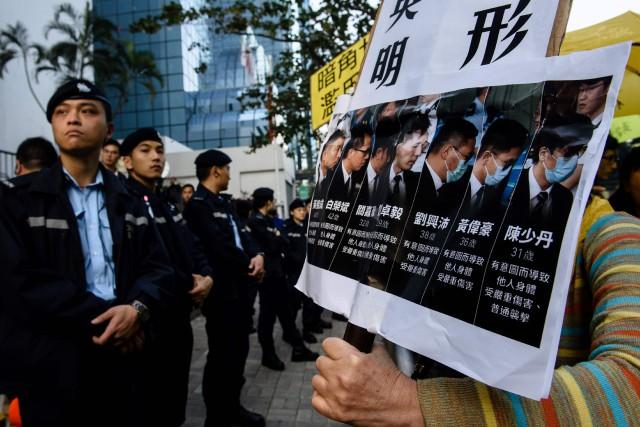 Les sept condamnés avaient été reconnus coupables en... (Photo Anthony WALLACE, AFP)