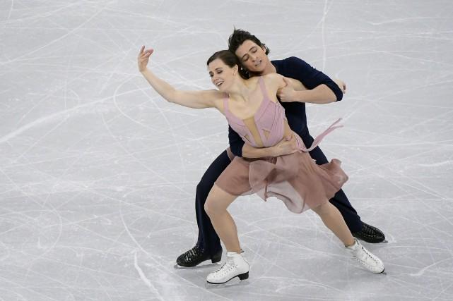 Tessa Virtue et Scott Moir... (Kim Doo-Ho, AFP)
