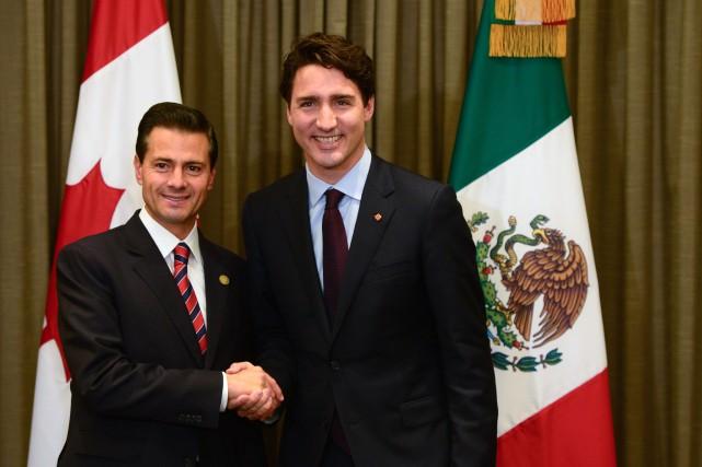 Le premier ministre Justin Trudeau accompagné du président... (Archives La Presse canadienne, Sean Kilpatrick)