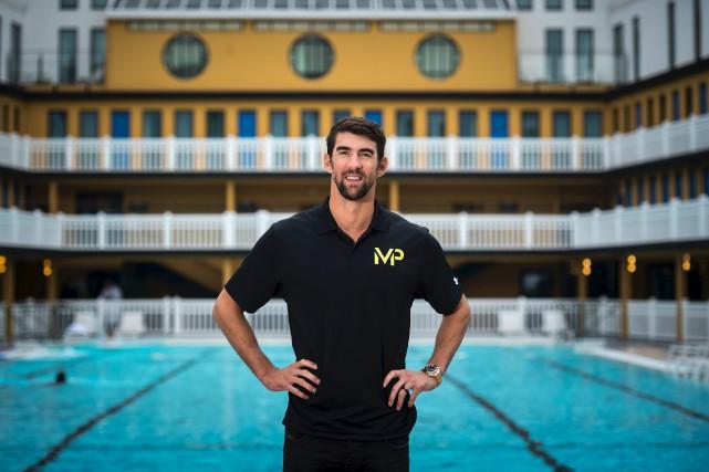Michael Phelps lors d'une session photo à la... (AFP, Lionel Bonaventure)