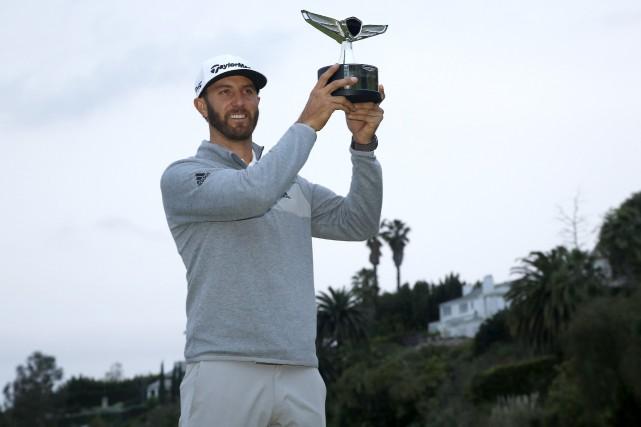 Le golfeur américain a réussi un oiselet à... (Photo AP)
