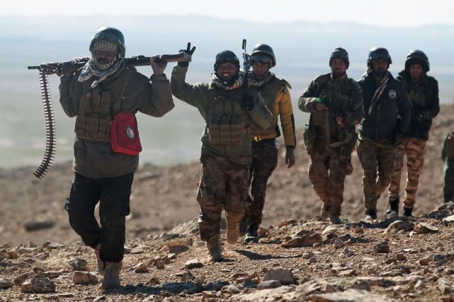 Les forces progouvernementales avaient déjà repris dimanche aux... (PHOTO AFP)