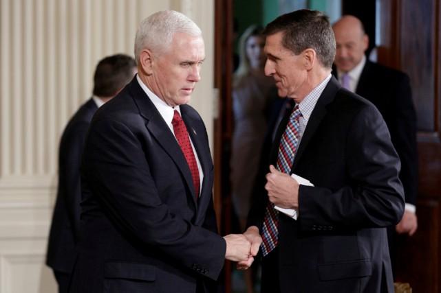 Mike Pence et Michael Flynn à la Maison-Blanche... (PHOTO REUTERS)