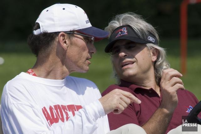 Marc Trestman et Jim Popp avec les Alouettes... (Photo Rémi Lemée, archives La Presse)
