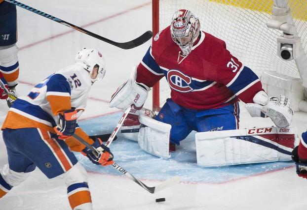 Carey Price a repoussé 21 tirs des Islanders,... (La Presse canadienne, Graham Hughes)