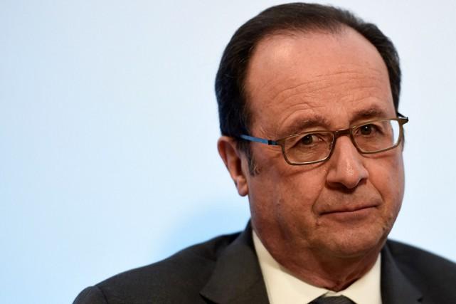 Le président français François Hollande... (PHOTO STEPHANE DE SAKUTIN, ARCHIVES AFP)