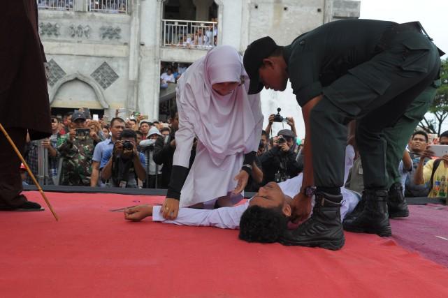 Herizal bin Yunus, 27 ans, a perdu connaissance... (Photo CHAIDEER MAHYUDDIN, Agence France-Presse)