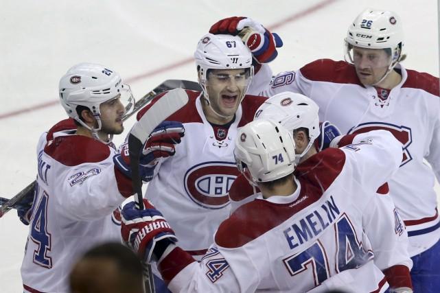 Le capitaine du Canadien, Max Pacioretty (au centre),... (AP, Mel Evans)