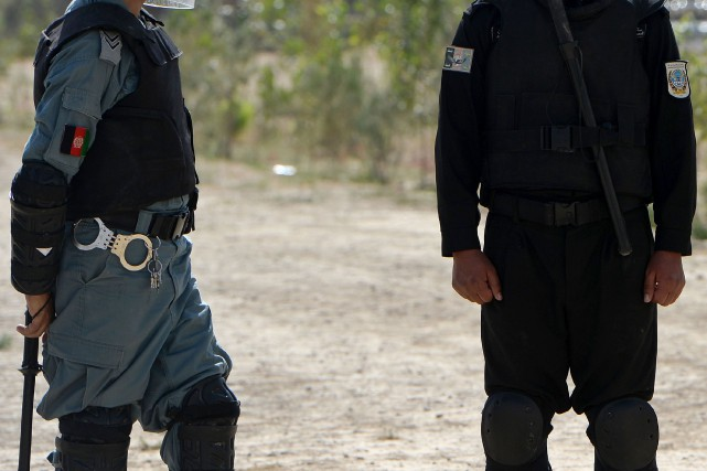 La police afghane... (Photo WAKIL KOHSAR, Archives AFP)