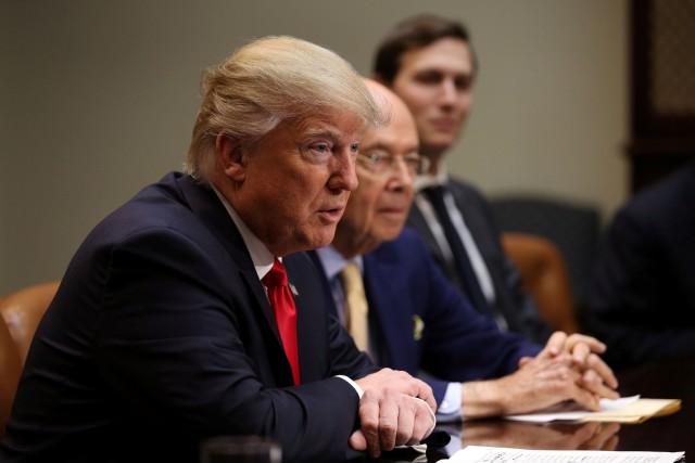 Installé à la Maison-Blanche, Donald Trump poursuit sans... (Photo Carlos Barria, REUTERS)