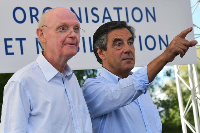 Francois Fillon et son directeur de campagne Patrick... (Photo JEAN-FRANCOIS MONIER, AFP)
