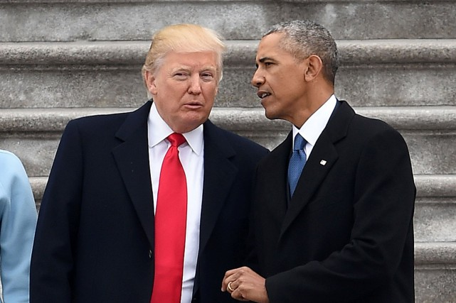 Barack Obama discute avec Donald Trump lors de... (PHOTO ROBYN BECK, ARCHIVES AGENCE FRANCE-PRESSE)