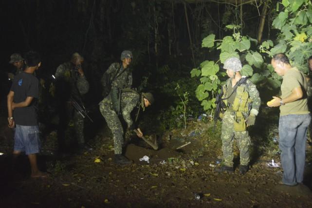 Cette photo du 28 février montre des soldats... (AFP, Nickee Butlangan)