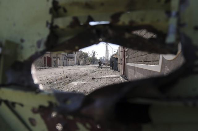 Les forces irakiennes mènent depuis le 19 février... (PHOTO AP)