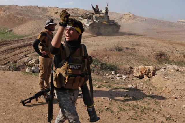 Les forces irakiennes ont encore progressé dans leur... (PHOTO AFP)
