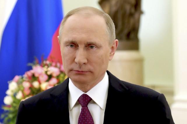 Le président russe Vladimir Poutine... (Photo Mikhail Klimentyev Le Kremlin/AP)