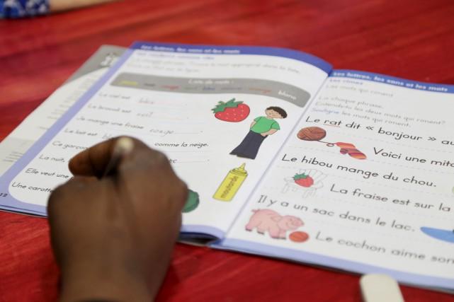 Pour arriver à apprendre à lire et à... (photo janick Marois)