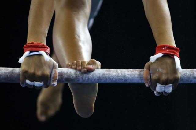 Depuis plusieurs semaines aux États-Unis, d'anciennes gymnastes sortent de leur... (PHOTO ARCHIVES REUTERS)