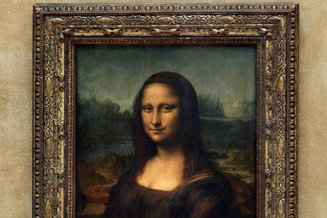 Le sourire de Mona Lisa, qui fascine depuis... (Archives AFP)