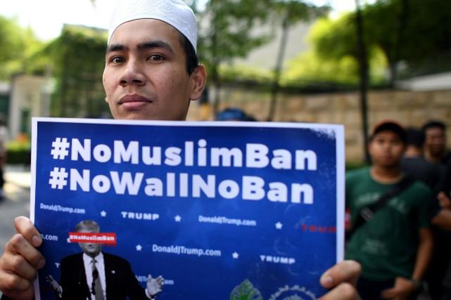 Le nouveau décret du président Trump, comme le... (Photo MANAN VATSYAYANA, AFP)