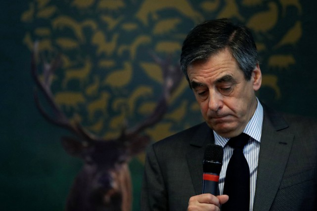 François Fillon... (PHOTO Christian Hartmann, REUTERS)
