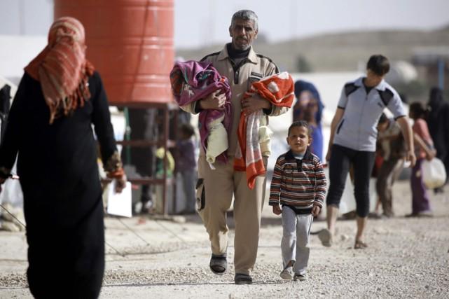 Un camp de réfugiés à la frontière entre... (PHOTO AFP)