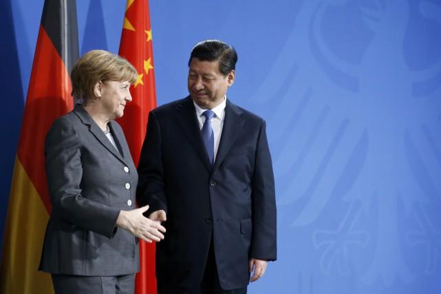 La chancelière allemande Angela Merkel et le président... (REUTERS)