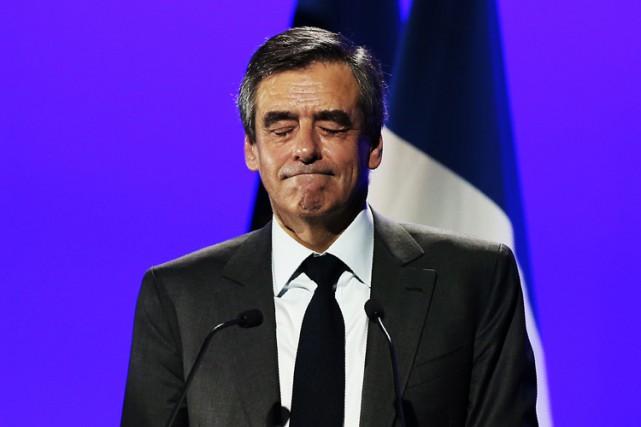 François Fillon a été inculpé mardi pour détournement... (PHOTO AFP)