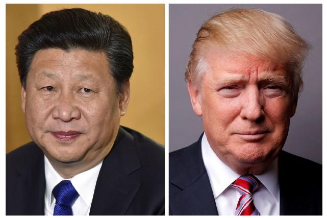 Le président chinois Xi Jinping et le président... (PHOTOS ARCHIVES REUTERS)